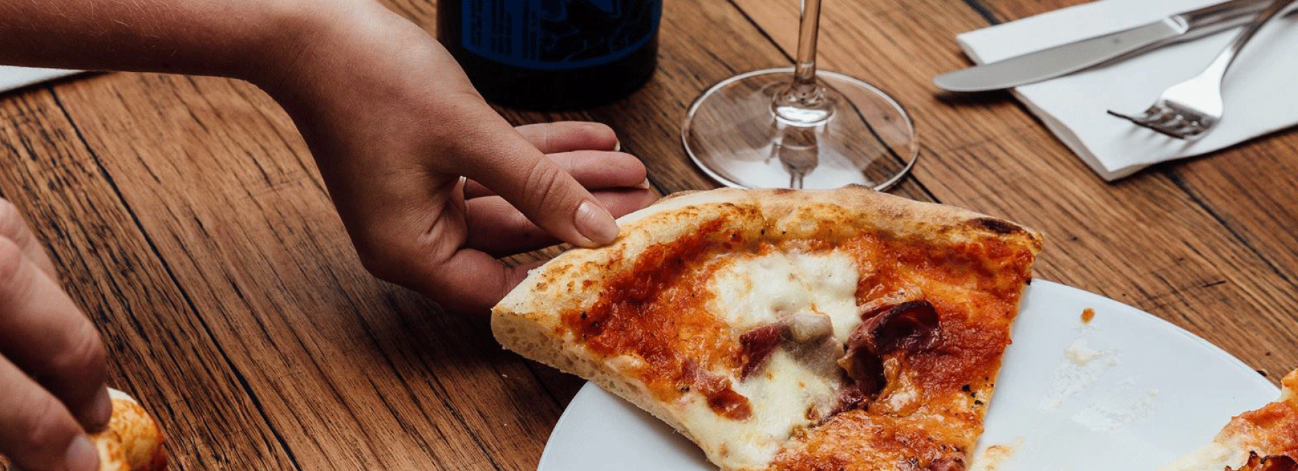 Pizza wine and hands cropped for web 17Jan19